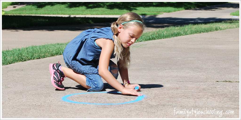 Draw a circle on the driveway with chalk